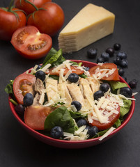 Fresh Salad with Chicken, Tomatoes Blueberries and Parmesean Cheese