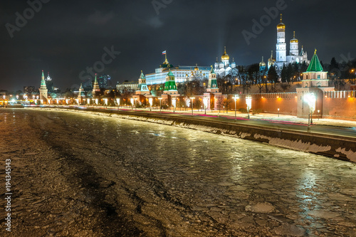 Night landscape with the image of frozen Moscow river near Kremlin in Moscow