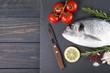 Raw fish dorado cooking and ingredients.
