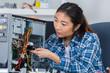 asian lady repairing computer