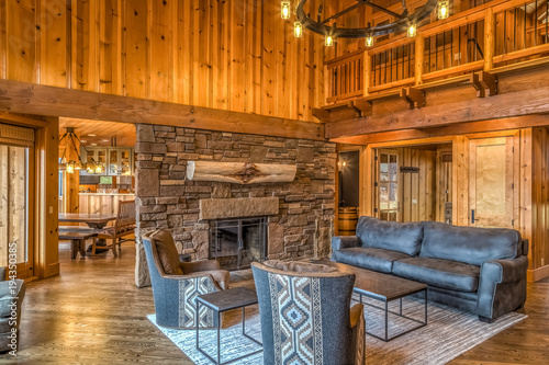Upscale rustic living room with stone fireplace