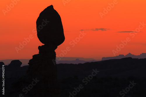 Fotobehang Koraal A silhouette of a balancing rock at sunset in Arches National Park.