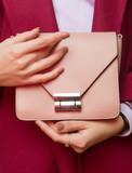 Fashionable girl  with  handbag close up. Stylish accessory. - 194362540