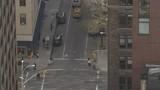 Busy Manhattan Midtown street, View from High-rise, tilt up along street, Pedestrian and Car Traffic, ExtremeLongShot - 194378597