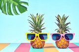 Two Hipster Fruits in Trendy Sunglasses, on Beach. Tropical Pineapple Couple. Bright Summer Color.Fashion Style. Creative Art. Fun Summer party Mood - 194383181