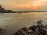 sun rise light at the rock beach with smooth wave - 194384189