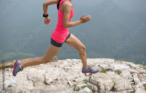 Foto op Canvas Jogging sporty fitness woman runner running on mountain top