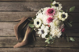 flat lay with bridal shoes and beautiful bouquet on wooden tabletop - 194398544