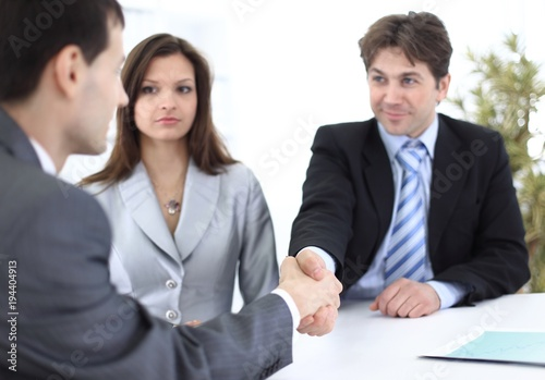handshake business partners in the workplace