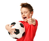 Fan sport boy player hold soccer ball in red t-shirt celebrating happy smiling laughing show thumbs up success sign - 194407181