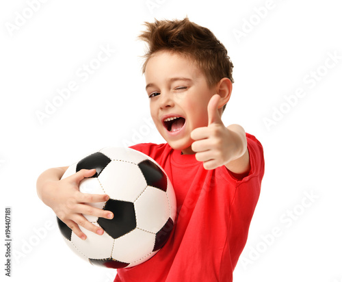 Leinwanddruck Bild Fan sport boy player hold soccer ball in red t-shirt celebrating happy smiling laughing show thumbs up success sign