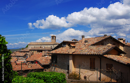 View of the medieval historic center of Montone, a small town in the Umbria countryside in Italy, with old Saint Francis Church and clouds