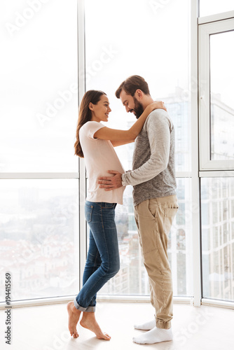 Pretty pregnant young couple hugging