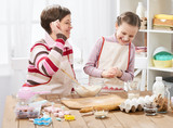 Mother and daughter cooking and having fun, home kitchen interior, healthy food concept - 194421149