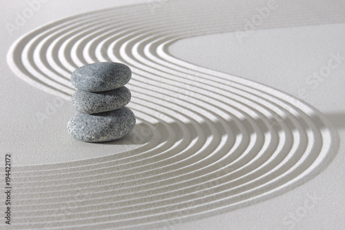 Fotobehang Zen Stenen Japanese ZEN garden with stacked rocks in white textured sand