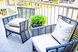 Chairs and green plant in new house closeup with decorations on balcony in staging model home or apartment - 194437789