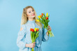 Pretty woman with red yellow tulips bunch - 194444501