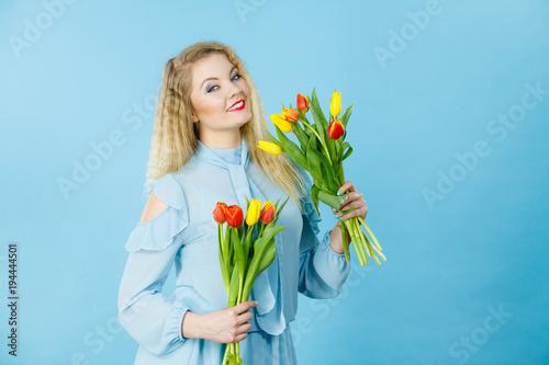 Staande foto Wanddecoratie met eigen foto Pretty woman with red yellow tulips bunch