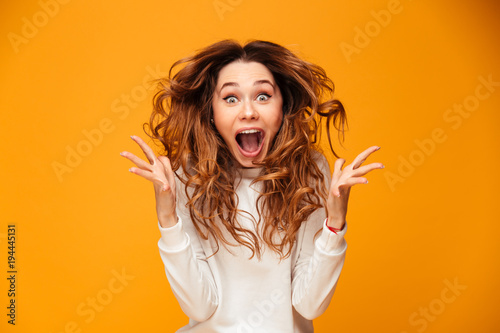 Leinwanddruck Bild Screaming young woman standing isolated