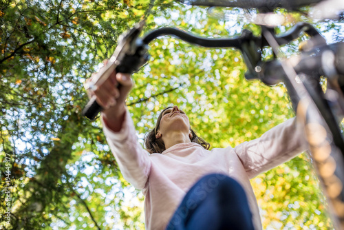 Woman riding a bicycle in autumn