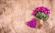 Delicate spring flowers and wicker heart. Romantic concept. Bouquet of violets. Copy space