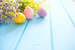 Colorful easter decorations on wooden plank