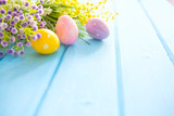 Colorful easter decorations on wooden plank - 194490174