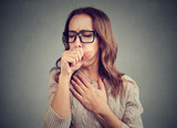 Sick woman coughing with pain