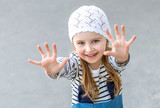 Small child reaching out with her hands - 194500908