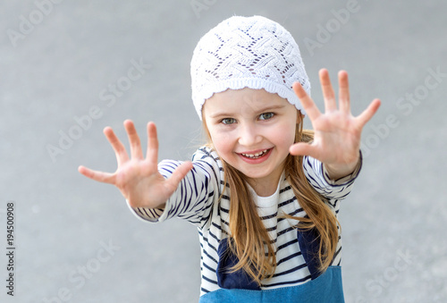 Small child reaching out with her hands
