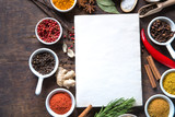 Open recipe book with fresh herbs and spices - 194503979