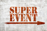 Super event -  graffiti on stucco wall