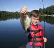 Young boy fishing for sunfish at the lake cabin