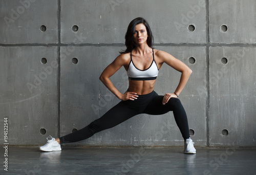 Fotobehang Fitness fitness female doing stretching exercise