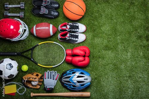 Foto Murales Various Sport Equipments On Grass