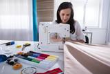 Fashion Designer Stitching Fabric On Sewing Machine