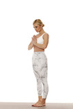 Yoga, sport, training and lifestyle concept.  Portrait of young beautiful woman in white sportswear on white background.