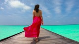 Woman in Red Dress  Walking on the Tropical Pier Dock Landscape with Blue Water in Slow Motion - 194573502