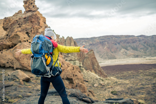 Super mom with baby boy hiking in backpack