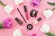 Leinwanddruck Bild Beauty composition with tulips flowers and cosmetics on pink background. Top view. Flat lay. Home feminine desk.