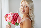 close up of woman with bunch of flowers - 194601379