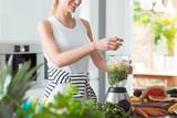 Happy vegan woman mixing vegetables - 194608507