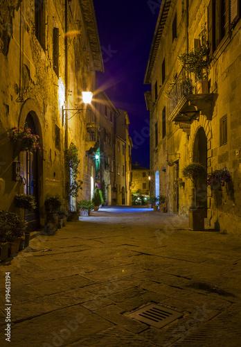 Fototapeta Street view at night. Pienza town in Tuscany region in Italy