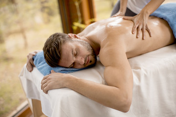 Young man having massage in the spa © Boggy