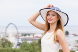 Attractive woman wearing sun hat and white top - 194625786