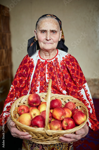 Farmer woman with a basket of apples