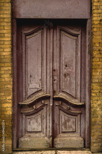 Wooden Ancient Italian Door In The Historic Center. Old European  Architecture. Two Fold