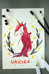 drawing of a cute unicorn on a table