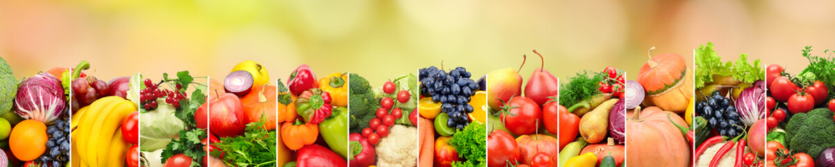 Healthy vegetables and fruits on multicolored blurred background.