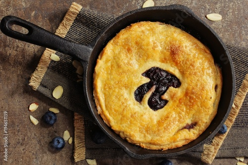 Wall mural Pi Day special homemade blueberry pie baked in a skillet overhead view
